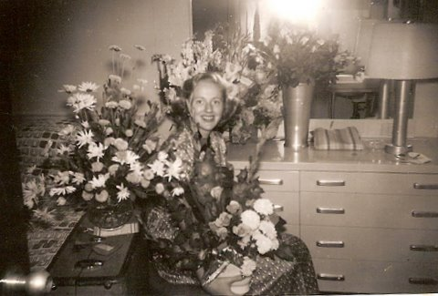 Beverley Jackson on the SS United States with flowers & trunk