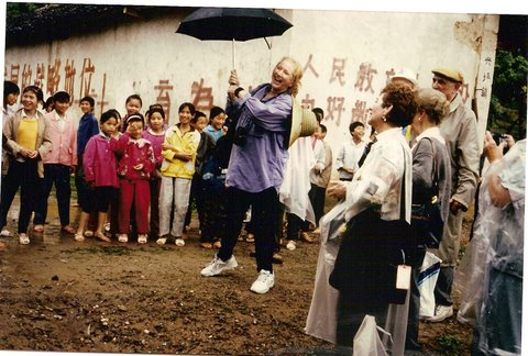 singing in the rain for school children remote Ming village 100 miles from Quilin