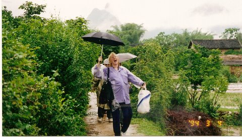 Singing in typhoon on way to Ming village school near Kunming 1997