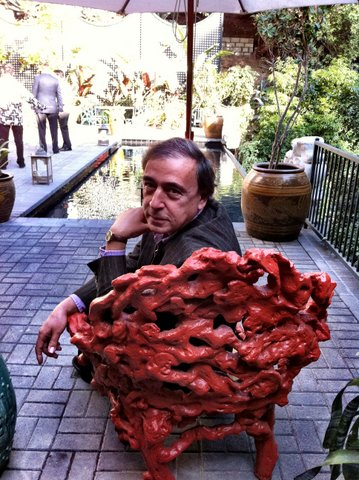 Gerald Incandela in coral chair