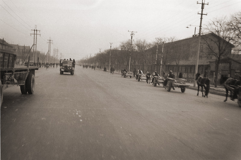 Heavy traffic on a Main Street in China during Cultural Revolution.